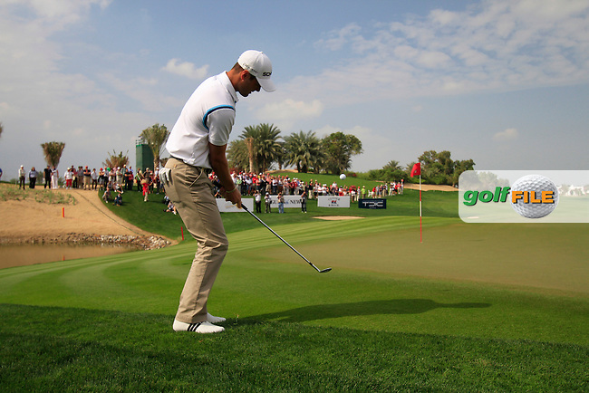 Martin Kaymer chips onto the 1st green during the Final Day Sunday of the Abu Dhabi HSBC Golf Championship, 23rd January 2011..(Picture Eoin Clarke/www.golffile.ie)