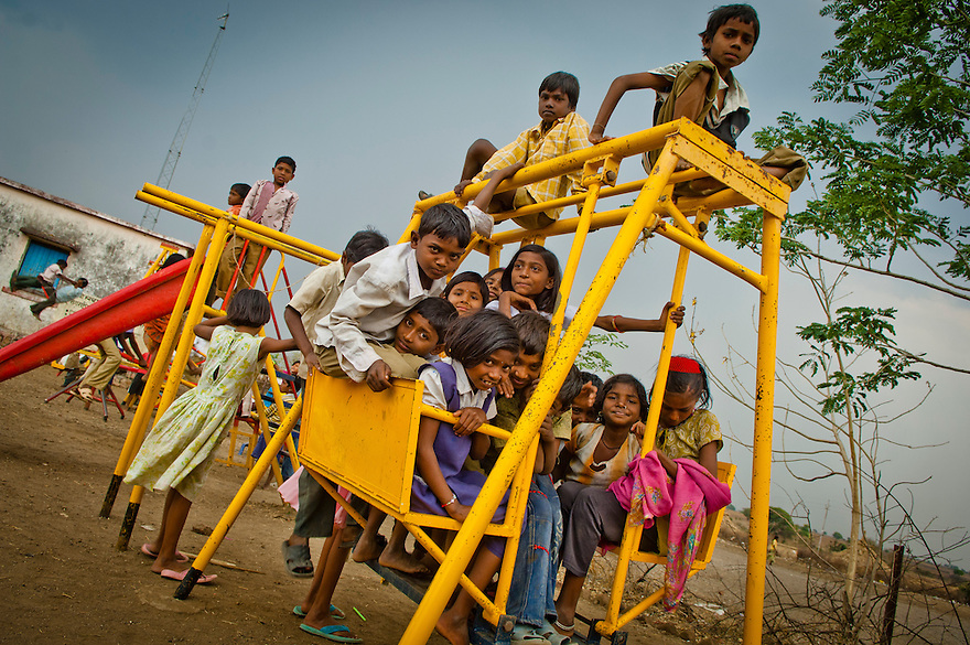 Indian schoolchildren gathers at their playground in a school in Karanwadi village in the Yavatmal district in the central Indian state of Maharashtra on the 24th of march 2011.