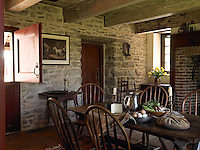 The original fireplace in the kitchen was replaced in the early 1800s by one in an open brick English-style and the pantry door leads to the sleeping loft upstairs