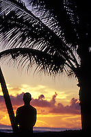 Surfer watching sunrise in the Philippines