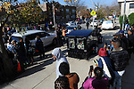 Mourners bid farewell to the casket of Tyshawn Lee, 9, who was shot multiple times while playing basketball in an alley on November 2, 2015, as it is pulled away by a motorcycle hearse outside St. Sabina's Church following Lee's funeral in Chicago, Illinois on November 10, 2015. Police allege the killing was a retaliatory gang hit which would mark a new turn in Chicago's gang wars.