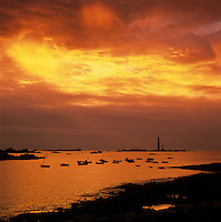 France, Brittany, near Plouguerneau: Boats and the Phare de la Vierge at sunset, Europe's highest lighthouse