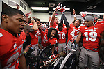 UNLV celebrates around the Fremont Cannon in the locker room following a rivalry NCAA football game against Nevada in Reno, Nev., on Saturday, Oct. 26, 2013. UNLV defeated Nevada 27-22.<br /> (AP Photo/Cathleen Allison)