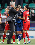 Olympique Lyonnais's coach Gerard Precheur (l) and the players Sarah Bouhaddi and Louisa Necib celebrate the victory in the UEFA Women's Champions League 2015/2016 Final match.May 26,2016. (ALTERPHOTOS/Acero)