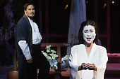 "London, UK. 25 February 2015. Hyeseoung Kwon as Cio Cio San Jeffrey Gwaltney as Pinkerton. Dress rehearsal of the Puccini opera ""Madam Butterfly"", staged in the round of the Royal Albert Hall. The opera is performed from 26 February to 15 March 2015. Directed by David Freeman with Oliver Gooch conducting the Royal Philharmonic Orchestra. Cast includes: Hyeseoung Kwon as Cio Cio San/Butterfly, Jeffrey Gwaltney as Pinkerton, David Kempster as Sharpless, Sabina Kim as Suzuki, Michael Druiett as The Bonze, Julius Ahn as Goro and Lise Christensen as Kate Pinkerton."