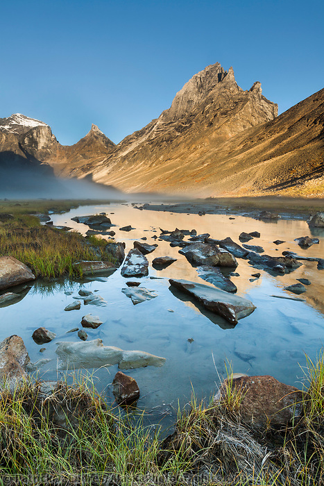 Mountain reflections of Xanadu, Arial and Caliban peaks, Arrigetch Peeks, Arrigetch creek, Gates of the Arctic National Park, Alaska.