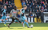 Stephen McGinn of Wycombe Wanderers under pressure from Stanley Aborah of Notts County during the Sky Bet League 2 match between Notts County and Wycombe Wanderers at Meadow Lane, Nottingham, England on 28 March 2016. Photo by Andy Rowland.