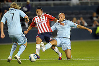 Marco Fabian (8) Chivas Guadalajara midfielder tries to get by Sporting KC defender Aurelien Collin (78)... Sporting Kansas City played Chivas Guadalajara to a 2-2 tie at LIVESTRONG Sporting Park, Kansas City, Kansas in an international friendly.