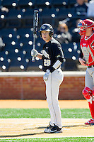 Garrett Kelly (28) of the Wake Forest Demon Deacons looks to his third base coach for the sign during the game against the Youngstown State Penguins at Wake Forest Baseball Park on February 24, 2013 in Winston-Salem, North Carolina.  The Demon Deacons defeated the Penguins 6-5.  (Brian Westerholt/Four Seam Images)