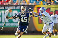 February 20, 2011:  Notre Dame midfield Max Pfeifer (45) fights to get past Duke midfielder Jake Tripucka (7) during Lacrosse action between the Duke Blue Devils and Notre Dame Fighting Irish during the Moe's Southwest SunShine Classic played at EverBank Field in Jacksonville, Florida. Notre Dame defeated Duke 12-7.