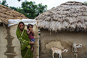 A woman stands with her daughter outside a hut in Bhelaiya village in Raxaul district in Bihar, India.