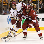 Matt Lombardi (Boston College - Milton, MA) and Doug Rogers (Harvard University - Watertown, MA) battle for the puck. The Boston College Eagles defeated the Harvard University Crimson 3-1 in the first round of the 2007 Beanpot Tournament on Monday, February 5, 2007, at the TD Banknorth Garden in Boston, Massachusetts.  The first Beanpot Tournament was played in December 1952 with the scheduling moved to the first two Mondays of February in its sixth year.  The tournament is played between Boston College, Boston University, Harvard University and Northeastern University with the first round matchups alternating each year.