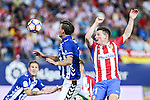 Atletico de Madrid's Kevin Gameiro and Deportivo Alaves's Alexis Ruano during the match of La Liga Santander between Atletico de Madrid and Deportivo Alaves at Vicente Calderon Stadium. August 21, 2016. (ALTERPHOTOS/Rodrigo Jimenez)