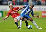 Manchester United's Paul Scholes tackles Wilson Palacios of Wigan Athletic during the Premier League match at The JJB Stadium, Wigan. Picture date 11th May 2008. Picture credit should read: Simon Bellis/Sportimage