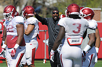 NWA Democrat-Gazette/ANDY SHUPE<br /> Arkansas assistant coach John Scott Jr. speaks to his players Saturday, April 1, 2017, during practice at the university practice field in Fayetteville. Visit nwadg.com/photos to see more photographs from practice.