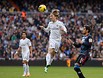 19	Luka Modric (Real Madrid) vies with     14 Recio (FC Granada) during the Spanish league football match Real Madrid vs FC Granada at the Santiago Bernabeu stadium in Madrid on January 25, 2014. PHOTOCALL3000/ DP