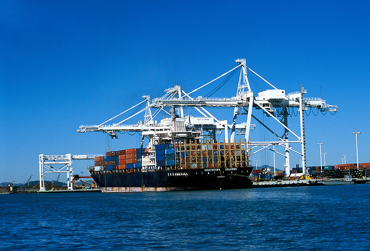 California: Oakland.  Container ship in harbor.  Photo caoakl103..Photo copyright Lee Foster, 510/549-2202, lee@fostertravel.com, www.fostertravel.com