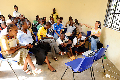 Hatua Likoni Foundation founder Gabrielle Fondiller speaks to her Foundation's high school scholarship students during a Sunday afternoon photography workshop sponsored by the Foundation.  The workshop was organized with photographer Todd Shapera on two consecutive Sundays, using cameras from U.S. donors.