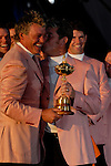 Lee Westwood plants a kiss on close friend Darren Clarke's cheek,  part of the victorious European Team, hold the Ryder Cup during the closing ceremony of the 2006 Ryder Cup at The K Club..Photo: Eoin Clarke/Newsfile.