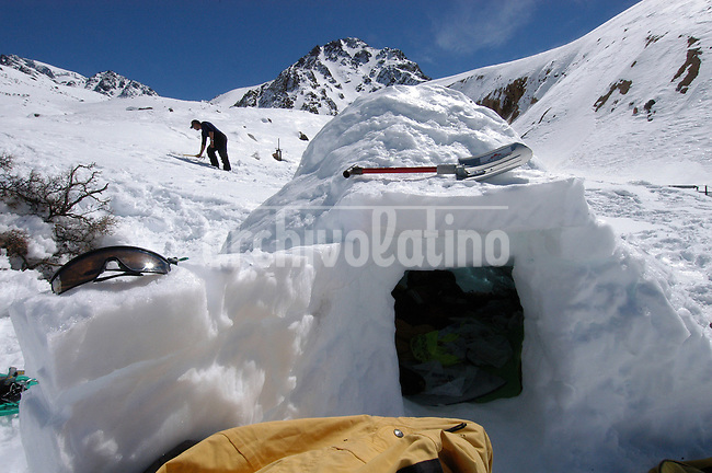 Trekkers  in Vallecitos,  a spot in the Andes moutain range, build an igloo to spend the cold night in the mountain.