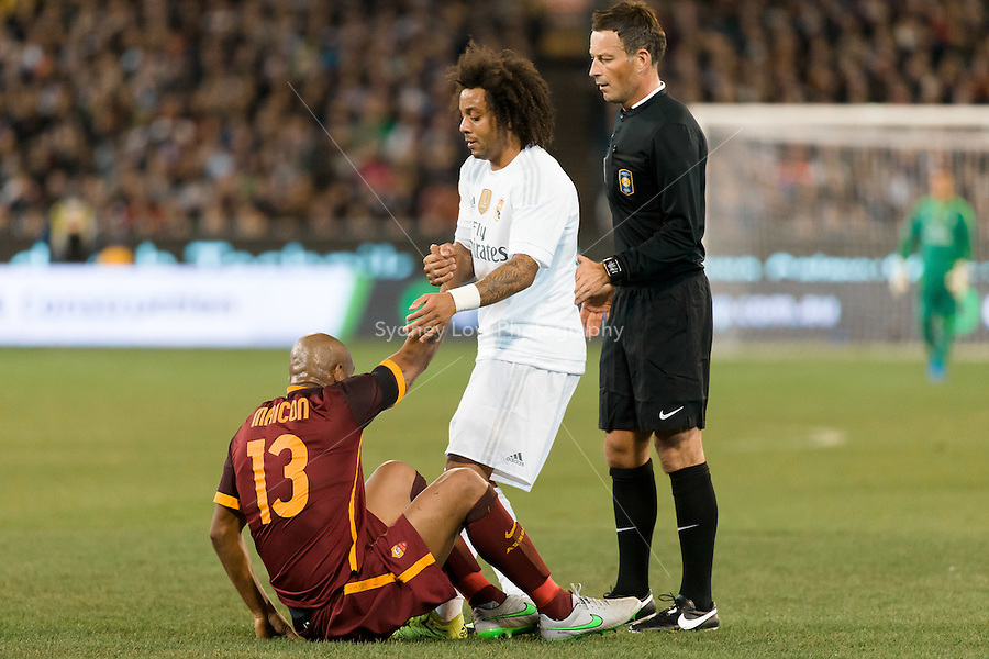 Melbourne, 18 July 2015 - Marcelo Vieira of Real Madrid helps Maicon of AS Roma in game one of the International Champions Cup match at the Melbourne Cricket Ground, Australia. Roma def Real Madrid 7-6 Penalties. Photo Sydney Low/AsteriskImages.com