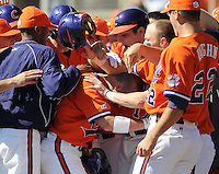 Boyd Wilson is congratulated after hitting a home run during the opening game of the 2008 season between the Mercer Bears and Clemson Tigers at Doug Kingsmore Stadium in Clemson, S.C.  Photo by:  Tom Priddy/Four Seam Images