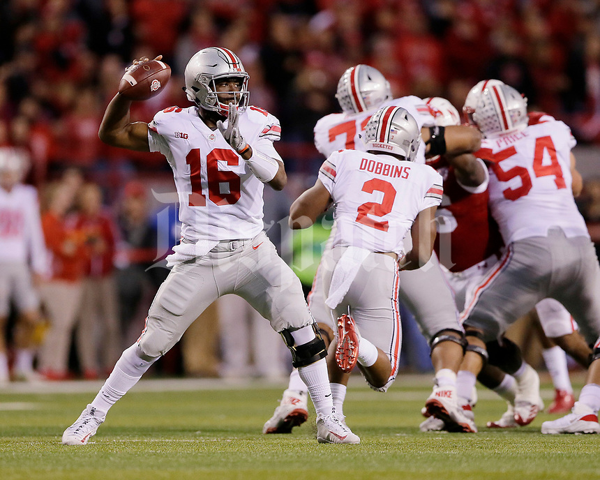 Ohio State Buckeyes quarterback J.T. Barrett (16) throws a screen pass during the first quarter of the NCAA football game against the Nebraska Cornhuskers at Memorial Stadium in Lincoln, Neb. on Oct. 14, 2017. [Adam Cairns/Dispatch]