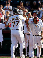 Josh Donaldson is greeted at home plate after hitting a three-run homerun in the seventh inning of the Arizona Fall League championship game to give the Phoenix Desert Dogs a 9-4 lead over the Mesa Solar Sox at Scottsdale Stadium - 11/22/2008..Photo by:  Bill Mitchell/Four Seam Images