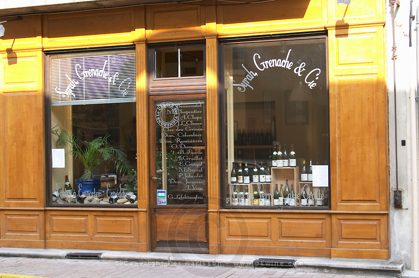 A wine shop window in Tain l'Hermitage called Syrah, Grenache et Compagnie, selling wines from many different growers in the district  Tain l'Hermitage, Drome, Drôme, France, Europe
