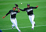 16 March 2009: Florida Marlins' infielder Manny Mayorson (left) and outfielder Alejandro De Aza (right) collide and drop the ball when chasing down a Wily Mo Pena pop foul during a Spring Training game against the Washington Nationals at Roger Dean Stadium in Jupiter, Florida. The Nationals defeated the Marlins 3-1 in the Grapefruit League matchup. Mandatory Photo Credit: Ed Wolfstein Photo
