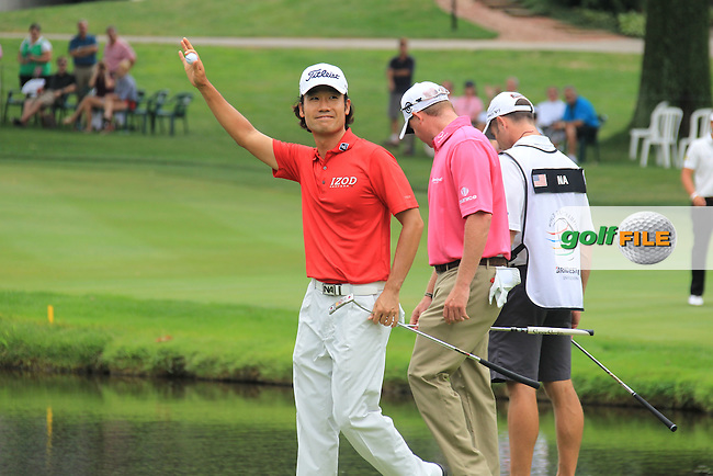 Kevin Na (USA) finds Joost Luiten's (NED) plugged ball at the 16th green during Sunday's Final Round of the 2012 World Golf Championship Bridgestone Invitational at The Firestone Country Club, Akron, Ohio, USA 5th August 2012 (Photo Eoin Clarke/www.golffile.ie)