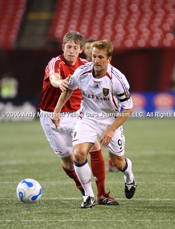 26 August 2006: Salt Lake's Jason Kreis (9) is chased by New York's John Wolyniec (behind). The New York Red Bulls defeated Real Salt Lake 6-0 at Giants Stadium in East Rutherford, New Jersey in a regular season Major League Soccer game.