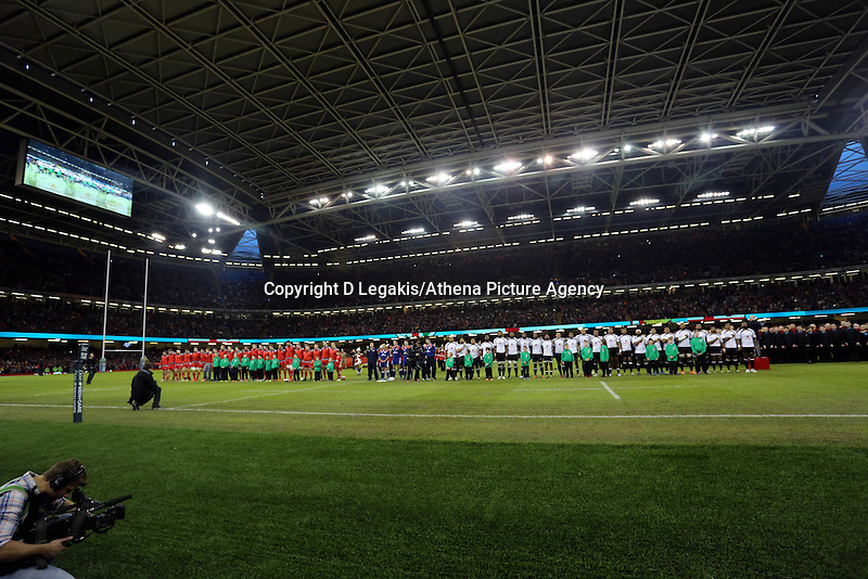 Pictured: Wales and Fiji players line up before kick off. Saturday 15 November 2014<br /> Re: Dove Men Series rugby, Wales v Fiji at the Millennium Stadium, Cardiff, south Wales, UK.