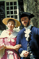 Caucasian couple in colonial period dress posing at Williamsburg historic site. white couple. Williamsburg Virginia USA.