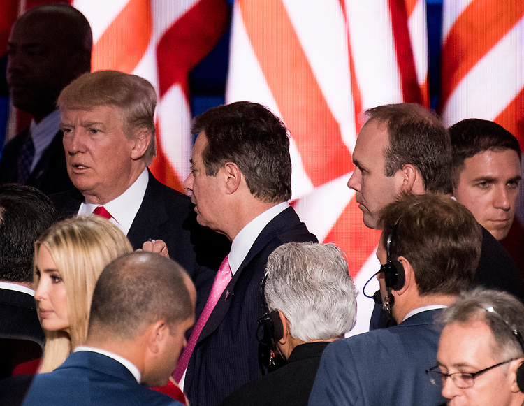 UNITED STATES - OCTOBER 30: FILE PHOTO From left, GOP Presidential candidate Donald Trump, campaign manager Paul Manafort and Rick Gates stand on stage during their podium check early Thursday afternoon in preparation for accepting the GOP nomination to be President at the 2016 Republican National Convention in Cleveland, Ohio on Wednesday July 20, 2016. (Photo By Bill Clark/CQ Roll Call)