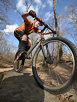 NWA Democrat-Gazette/BEN GOFF @NWABENGOFF<br /> Calvin Smyder, 13, of Lowell practices hopping up and down rock ledges on Sunday Feb. 28, 2016 during a NWA Bike Trials group ride at Park Springs Park in Bentonville.