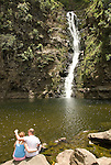 Hawaii: Molokai, Halawa Valley, couple at waterfalls, after hike in past taro fields, ancient walls, to waterfalls, guided by Lawrence Aki. Model released..Photo himolo237-72034..Photo copyright Lee Foster, www.fostertravel.com, lee@fostertravel.com, 510-549-2202