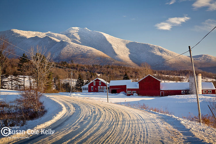 A red farm beneath Mount Mansfield in Underhill, VT, USA