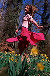 A912J1 Girl dancing in daffodil woods