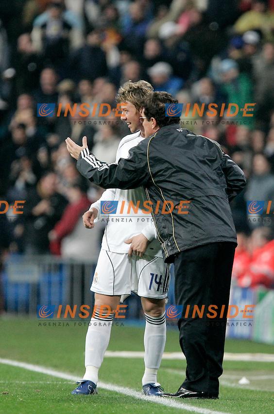 Real Madrid's coach Fabio Capello delivers instructions to Jose Maria Gutierrez during UEFA Champions League match at Santiago Bernabeu stadium in Madrid, Tuesday February 20, 2007. (ALTERPHOTOS/Alvaro Hernandez).