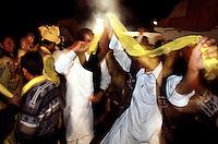 People from the upperclass in Lahore are dancing at the Basant festival in Lahore. A festival for greeting the spring.<br /> 17.2.2001, Lahore/Pakistan<br /> Copyright: Christian-Ditsch.de<br /> [Inhaltsveraendernde Manipulation des Fotos nur nach ausdruecklicher Genehmigung des Fotografen. Vereinbarungen ueber Abtretung von Persoenlichkeitsrechten/Model Release der abgebildeten Person/Personen liegen nicht vor. NO MODEL RELEASE! Nur fuer Redaktionelle Zwecke. Don't publish without copyright Christian-Ditsch.de, Veroeffentlichung nur mit Fotografennennung, sowie gegen Honorar, MwSt. und Beleg. Konto: I N G - D i B a, IBAN DE58500105175400192269, BIC INGDDEFFXXX, Kontakt: post@christian-ditsch.de<br /> Bei der Bearbeitung der Dateiinformationen darf die Urheberkennzeichnung in den EXIF- und  IPTC-Daten nicht entfernt werden, diese sind in digitalen Medien nach §95c UrhG rechtlich geschuetzt. Der Urhebervermerk wird gemaess §13 UrhG verlangt.]