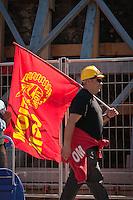 Operaio con bandiera della FIOM durante lo Sciopero Nazionale della CGIL, in Abruzzo il corteo della protesta si è svolta nella zona rossa della città de L'Aquila ad un anno dal terremoto. 25/06/2010 Photo: Adamo Di Loreto/BuenaVista*Photo