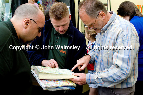 The Head and drivers check the route.  State Junior school prepare for coach trip. .