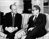 "United States Secretary of State Henry A. Kissinger, right, meets United States President Gerald R. Ford, left, in the Oval Office at the White House in Washington, D.C. on February 19, 1975 to report on his 10 day trip to Egypt and Israel.  Kissinger later told reporters that Syria was in the way of peace in the middle east.  He was firm in his belief there would someday be peace in the region.<br /> Credit: Benjamin E. ""Gene"" Forte - CNP"