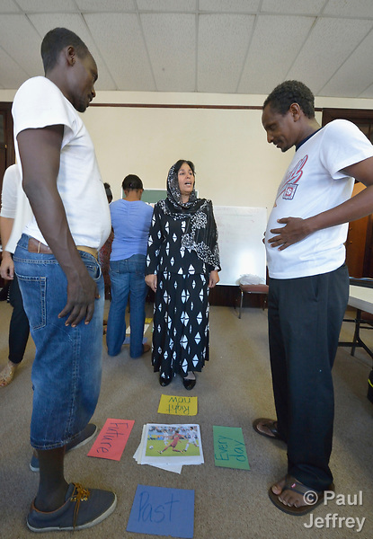 Participants in a cultural orientation class for newly arrived refugees, held in a church in Lancaster, Pennsylvania, discuss verb tenses in English. The class is sponsored by Church World Service. <br /> <br /> Photo by Paul Jeffrey for Church World Service.