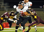 SIOUX FALLS, SD - OCTOBER 31:  Zac Brown #18 from Huron returns the opening kickoff and is brought down by Kristian Jakowicz #34 and Aiden Miller #87 from Harrisburg in the first quarter of their quarterfinal round game of the 11AA Playoffs Thursday night in Harrisburg. (Photo by Dave Eggen/Inertia)