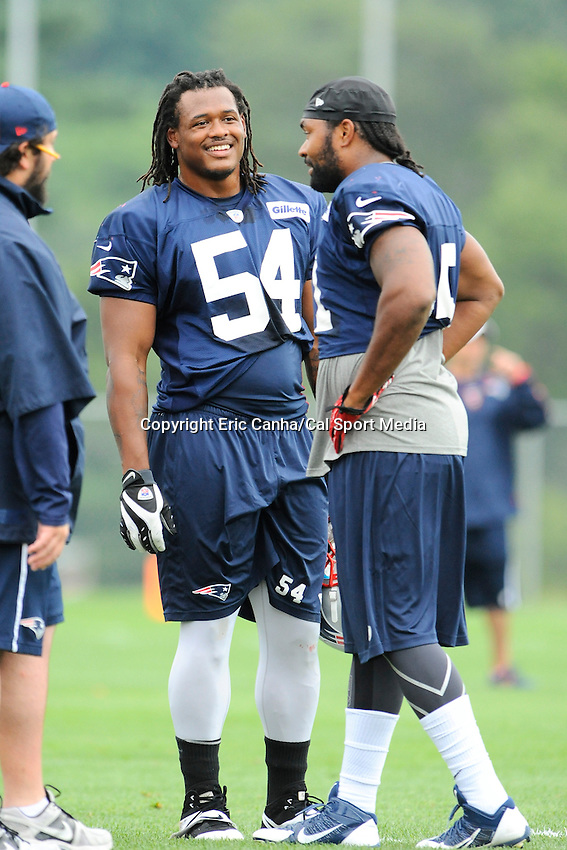 August 3, 2013 - Foxborough, Massachusetts, U.S. - New England Patriots linebacker Dont'a Hightower (54), linebacker Jerod Mayo (51) and defensive coordinator Matt Patricia talk during the New England Patriots training camp at Gillette Stadium in Foxborough Massachusetts.   Eric Canha/CSM