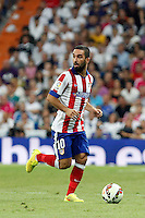 Arda Turan of Atletico de Madrid during La Liga match between Real Madrid and Atletico de Madrid at Santiago Bernabeu stadium in Madrid, Spain. September 13, 2014. (ALTERPHOTOS/Caro Marin)