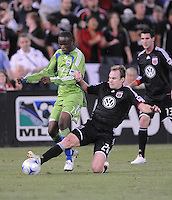 DC United defender Bryan Namoff (26) slides to defend the play against Seattle Sounders FC. defender James Riley (7)  The Seattle Sounders FC defeated DC United 2-1at RFK Stadium, Saturday September 12 , 2009.