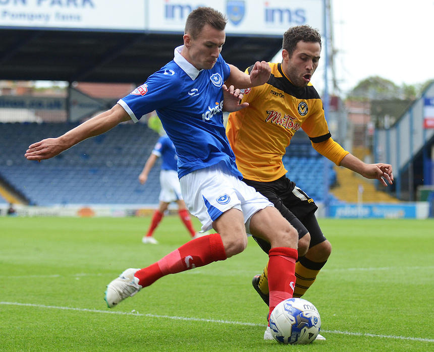 Portsmouth's Jed Wallace under pressure from Newport County's Robbie Willmott<br /> <br /> Photographer Kevin Barnes/CameraSport<br /> <br /> Football - The Football League Sky Bet League Two - Portsmouth v Newport County AFC - Saturday 30th August 2014 - Fratton Park - Portsmouth<br /> <br /> &copy; CameraSport - 43 Linden Ave. Countesthorpe. Leicester. England. LE8 5PG - Tel: +44 (0) 116 277 4147 - admin@camerasport.com - www.camerasport.com